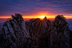 The Lion's Roar (Hilton Chen) Tags: autumn huangshannationalpark dwarfpines colorfulsky sunrise starburst seaofclouds landscape granitepeaks anhuiprovince china yellowmountains huangshanshi anhuisheng cn