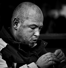 Fiddly (Neil. Moralee) Tags: austria2018neilmoralee neilmoralee fiddly fidley fiddley man face portrait close concentration difficult complicated bald balding cropped shaved head black white blackandwhite bw bandw whiteandblack mono monochrome candid austria frown scowl ring weddingring proposal propose cold dark detailed nautical neil moralee nikon d7200 innsbruck street mature stubble thug