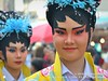 2018-02a Bangkok Chinatown (27) (Matt Hahnewald) Tags: matthahnewaldphotography facingtheworld live aesthetic springfestival chinesenewyear parade performer dancer makeup lunaryear festival head face painted eyes eyecontact costume consent fun entertainment travel tourism culture tradition enjoyment socialevent diversity impact traditional cultural folklore touristattraction celebration historical yaowarat bangkok chinatown thailand thaichinese asia twopeople image photo faceperception physiognomy nikond3100 nikkorafs50mmf18g primelens 50mm 4x3 horizontal street portrait doubleportrait closeup headshot seveneighthsview outdoor color colorful posingforcamera iconic awesome incredible authentic sightseeing photographing partying photography ambiguity uniform attire