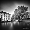 Nostalgic Bruges III (Alec Lux) Tags: bnw architecture belgium blackandwhite bricks bridge bruges brugge building buildings canal city daylight house landscape longexposure medieval nature old street tree water vlaanderen be