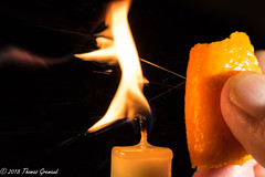 A Little Squeeze of Orange Oil (Thomas Gremaud) Tags: parlortrick flame citrus macro squeeze orangeoil spray macromondays orange candle