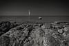 远方的灯塔 (黑色警铃) Tags: 海南 三亚 石头 广角 海边 灯塔 前景