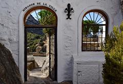 Room with a view (Jocelyn777) Tags: windows gate doorsandwindows villages whitevillages pueblosblancos stone view mountains trees foliage vista mirador zuheros andalucia spain travel