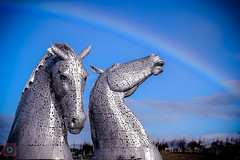A rainbow over the Kelpies, Falkirk, Scotland (picsbyCaroline) Tags: animal horses scotland falkirk kelpies helix sculpture structure metal tourist magnificent united kingdom sun statue bright shapes curves