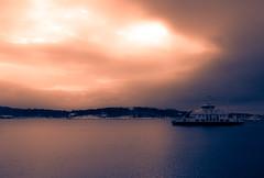 Ayay Captain (evakongshavn) Tags: sunshine water ship ferry sun clouds sky sunset new light pastel wordsofwisdom blahblahscape blahblah winter snow