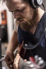 focused on sound (allanodyne) Tags: man beard bearded headphones sound guitar prs strings fretboard musician studio recording belt