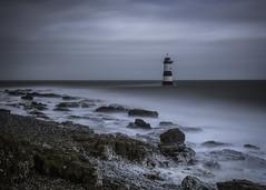 Deceptively Benign (markrd5) Tags: wales anglesey blackpoint trwyndulighthouse lighthouse longexposure le nikon1024mm 10stop leefilters ndgrad mood atmosphere waterrocksands foam spray