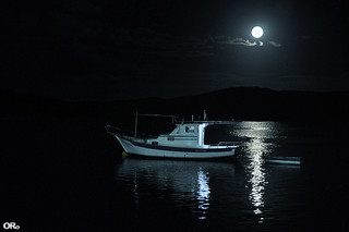 Super blue blood moon and boats