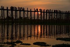 Sunset at the U Bein Bridge (Kathy~) Tags: sunset bridge silhouette myanmar burma reflection water lake people many wood veritical 15challengeswinner
