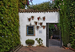 Viana Palace Gardens (Jocelyn777) Tags: foliage trees plants flowers gate windows courtyard patio palace monuments vianapalace cordoba andalucia spain travel