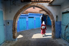 The Woman in the Light (Alex L'aventurier,) Tags: chefchaouen maroc morocco street rue candid femme woman bleu blue red rouge medina médina old vieux historique historical historic light lumière shadow city ville urban urbain arch arche architecture doors portes alley person people personne ombre