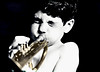 blowing his own horn .... (daystar297) Tags: portrait kid boy child fun music trumpet playing selectivecolor bw bnw blackandwhite horn emotion