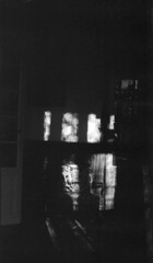 P56-2017-007 (lianefinch) Tags: blackandwhite blackwhite noirblanc noiretblanc bw nb argentique argentic analogique monochrome contraste contrast chiaroscuro clair obscur intérieur indoor sun light lumière soleil ombre shadow living room séjour armchair fauteuil