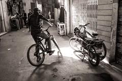 Bikes (Tom Levold (www.levold.de/photosphere)) Tags: fuji fujixpro2 isfahan bazaar sw xf18mm street bw basar esfahan people candid bicycle fahrrad