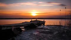 Broken Pier Sunrise (Jens Haggren) Tags: morning sunrise sun light sky clouds sea seascape water reflections pier broken ice winter reed longexposure le landscape view nacka sweden olympus em1 jenshaggren