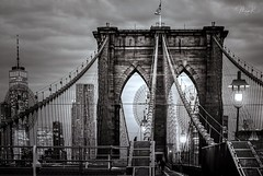 Welcome to a New Day (Maya K. Photography) Tags: brooklynbridge manhattan brooklyn bridge bw bwphoto monochrome buildings buildingstructure buildingcomplex owtc streetsofmanhattan steel architecture light lights shadows city cityphotography cityscape citylights newyork ny nyc america usa us unitedstatesofamerica sunrise blackandwhite blackandwhitephoto blackandwhitephotography morning day steelbridge eastriver river oldestroadwaybridge icon iconofnewyorkcity mayak mayakphotography