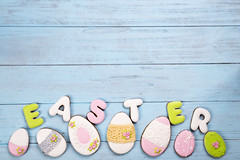 Sweets for celebrate Easter. Gingerbread in shape of easter eggs and letter Easter. (lyule4ik) Tags: easter background celebration decoration decorative egg food holiday season spring tradition wood wooden happy cookies concept design natural rustic springtime texture traditional banner biscuits card celebrate closeup eggs filter flower wishes toned sprinkles white colored letter brown nest frosting bright homemade basket horizontal april shortcrust text sweet chicken nobody bakery