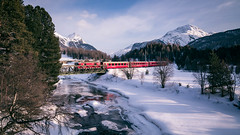 Rhätische Bahn crossing Swiss Alps. (icarium.imagery) Tags: sigma24105mmf4dgoshsmart canoneos5dmarkiv water snow landscape winter travel nature landschaft reise schnee switzerland puntmuragl sameden engadin train rhätischebahn swissalps alpine frozenriver