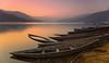 Phewa Lake Pokhara (Aubrey Stoll) Tags: fewa phew phewa lake nepal asia mountains sunset water reflections boats sunken rubbish stillness wood moored hills pokhara holiday tourism visitor