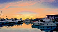 Dusk at the marina - Limassol, Cyprus (Andreas Komodromos) Tags: boat clouds cyprus house light limassol marina mediterranean pier reflection sea seafront shadow sky sunlight sunset travel villa water waterfront yacht seascape port dock color dusk afternoon winter tourist vacation landscape
