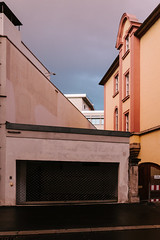 Magentic Evening (Thomas Listl) Tags: thomaslistl color architecture street urban würzburg evening mood atmosphere warm magenta garage windows houses buildings naturallight sunlight sky vsco