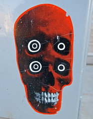 Four Eyes, Washington, DC (Robby Virus) Tags: washington dc districtofcolumbia sticker slap orange skull four eyes teeth head