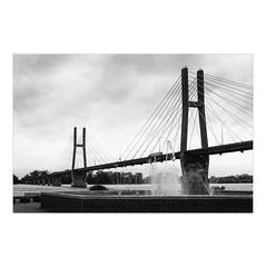 Bridge (greenschist) Tags: kodagold200 mississippiriver quincy fountain asahipentaxspotmaticii water film blackwhite supertakumar55mmf18 truck bridge analog illinois