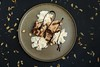 Chocolate bread pudding, whipped cream, hazelnuts and chocolate sauce. (annick vanderschelden) Tags: chocolate liquor bread pudding pressurecooker slices milk egg pottery plate served layering frosting baking food decorative whippedcream cream sauce belgium