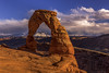 Delicate Arch with La Sal Mountains (Eunice Eunjin Oh) Tags: delicatearch archesnationalpark utah moab sandstonefins sunset natural outdoorphotographer landscape arch clouds lasalmountains outdoorproject