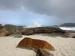 Passing shower (Diepflingerbahn) Tags: squeakybeach wilsonspromontory victoria rocks rain shower sand sea coast breakingwave lichen