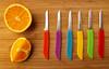 Cutting Edge (arbyreed) Tags: arbyreed knolling knollingphotography flatlayphotography knives knife cuttingboard bamboocuttingboard close closeup orange red blue