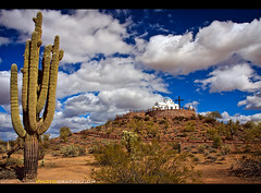 An Oasis in the Desert (Sam Antonio Photography) Tags: religion prayer orthodox old saint sky white travel tourism holiday religious cross blue architecture church greek desert clouds cactus arizona chapel style cacti storm