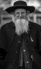 Smiling Mennonite Man (crabsandbeer (Kevin Moore)) Tags: winter amish farm hats mennonite mudsale people rural spring smile smiling bw glasses man portrait candid street person beard religion elder pennsylvania pa pennsylvaniadutch tradition