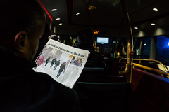 Evening Paper (graufuchs) Tags: europe europa england greatbritain london bus evening dark commuter fuji fujifilm fujifilmxe2 23mm 23mmf2 wideangle weitwinkel zeitung paper newspaper