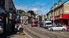 Street tram (Peter Leigh50) Tags: tram street road track car van people shop building wires sunshine shadows town