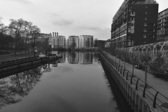 Aqua City (Robin Shepperson) Tags: monochrome berlin germany moabit d3400 nikon city towers reflection trees path digger barge bw black white grey landscape canal river architecture engineering flats