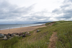Inverness Beach (Cape Breton Island Summer 2017) (TheNovaScotian1991) Tags: capebretonisland invernesscounty invernessbeach grassydune sand dune dramaticsky clouds novascotia canada atlanticocean island path nikond3200 afsdxnikkor1855mmf3556gvrii water rocks beach beautiful volleyballnet waves grass person cliffs landscape