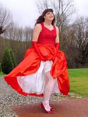 Sensual display (Paula Satijn) Tags: sexy hot upskirt legs stockings heels pumps lace petticoat girl lady red dress gown ballgown outside wind storm skirt satin silk silky happy joy smile gloves pretty beauty feminine girly elegant