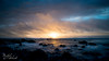 Blue Wave Sunsets (Maikel van Schaik) Tags: new zealand sunset waves water ocean sea blue yellow rays sun summer clouds rocks nikond600 24 28 nd8 filter neutral density camera beach pebbles sky nature landscape