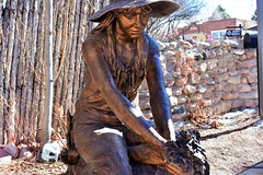 'In the Garden' (thomasgorman1) Tags: bronze sculpture art nm nikon gallery santafe woman outdoors fence stone tree