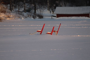 The three kick sleds on the snowy pier.