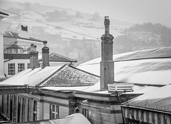 Behind the scenes (Rookie Phil) Tags: outdoor daytime winter wintry snowing snow lyingsnow rooftops snowcoveredrooftops chimneys buildings architecture snowcladhill railwaystation steamrailway england devon dartmouth kingswear bw blackandwhite monochrome 2401200mmf40 d750 nikond750