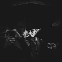 Любопытство / Prying eyes (Yuri Balanov) Tags: pry eyes faces streetphoto streetphotography moment situation people bwphoto rain blackandwhite black white umbrella summerrain pentax pentaxricoh pentaxk20d tamron tamron2875