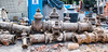 2018 - Mexico City - Condesa - Used Water Pipe (Ted's photos - For Me & You) Tags: 2018 cdmx cityofmexico cropped mexico mexicocity nikon nikond750 nikonfx tedmcgrath tedsphotos tedsphotosmexico vignetting condesa coloniacondesa pipes oldpipes valves pipevalves oldpiping waterpipe streetscene street sanirent barrels bricks mesh wiremesh tarp rustypipe wideangle widescreen