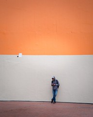 Orange wall (jameswilkinson1) Tags: color wall man nike urban streetphotography street leica orange