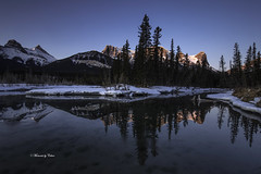 Policeman's creek dawn (Canon Queen Rocks (2,060,000 + views)) Tags: reflections mountains mountain sunrise trees creek policemanscreek colours canada canmore snow ice water momentsbycelinecom nature bluesky blues peaks lake tree sky serene landscape forest