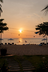 End of the Day - _TNY_3962 (Calle Söderberg) Tags: canon canon5dmkii canoneos5dmarkii tamron tamronafsp247028divcusd tamronsp2470mmf28divcusd 2470 sunset vietnam phuquoc mercuryphuquocresortvillas sea beach water orange sun sky beachchairs f4 5d2