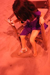 Esme shaking sand out of her shoes (olive witch) Tags: 2017 abeerhoque bangladesh bd coxsbazar dec17 december fem kid night outdoors red