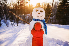 He needed him to look just right (Elizabeth Sallee Bauer) Tags: active boy building child childhood children cold fun happiness kid outdoors outside playing snow snowman white winter youth