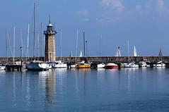 Lighthouse of Desenzano (annalisabianchetti) Tags: lighthouse faro desenzano harbor porto lake lagodigarda lakegarda water acqua boats barche blue paesaggio landscape travel